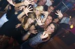 3307788-group-of-young-people-dancing-and-enjoying-inside-a-night-club